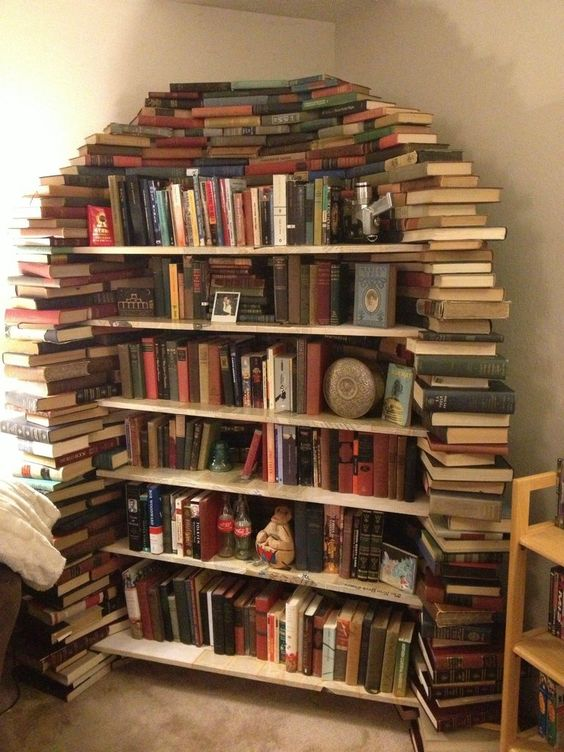 Photo: an overflowing bookshelf