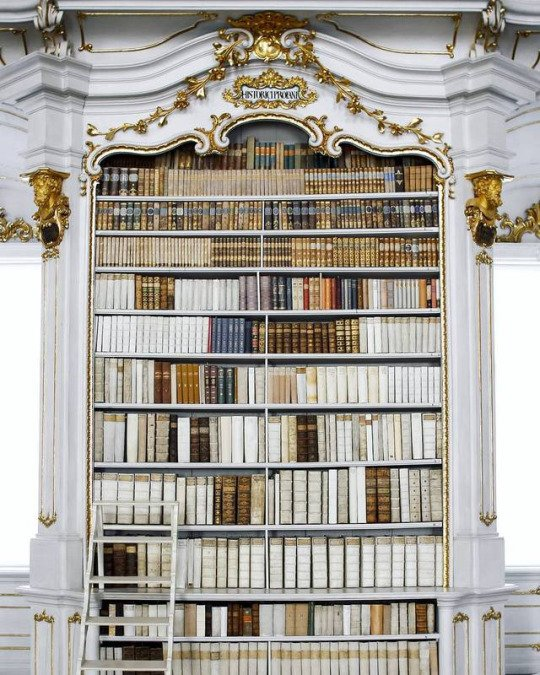 Photo: a grand old-fashioned bookcase filled with magnificent books, via Bookstr on Twitter