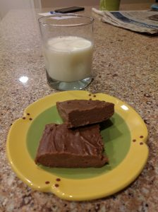 Photograph of two pieces of fudge and a glass of milk: yummy!