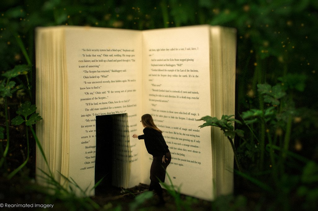 Image: a human figure disappearing into a book. Via Reanimated Imagery