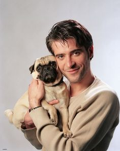 Photo: actor Goran Višnjić holding a pug