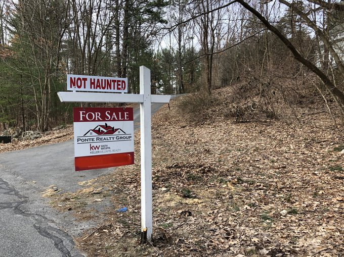 Photo of a real-estate sign: NOT HAUNTED, shared via LisaBerne.com